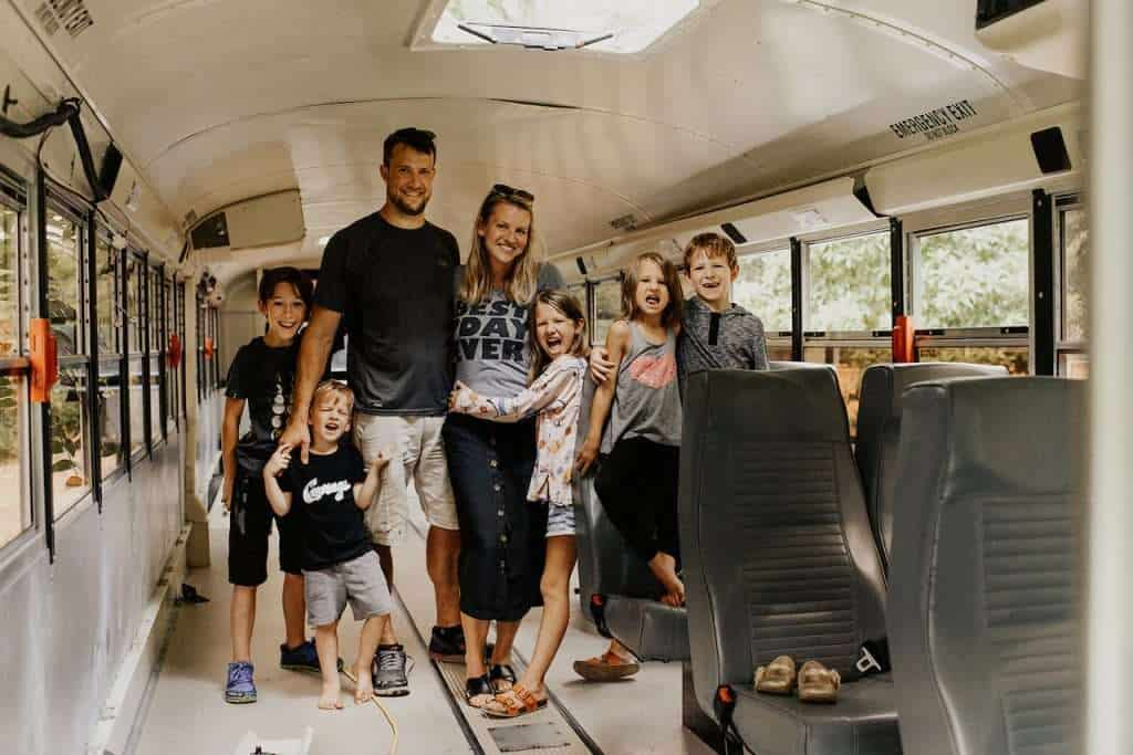 Spearing family stainding inside of a school bus.