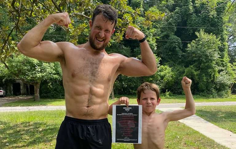 Nathan Spearing and son flexing after completing a workout regimen.