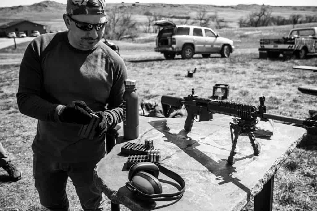 Man loading bullets into a magazine.